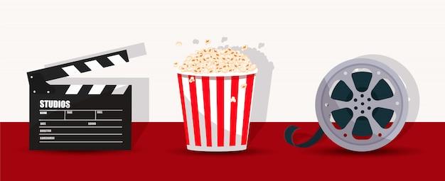 Попкорн, с 'хлопушкой' и киноленты.