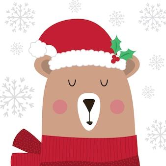 白い背景の上のサンタ帽子でかわいいクリスマスのクマ
