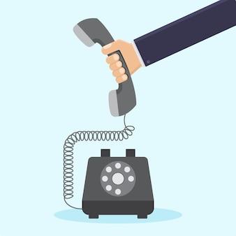 レトロな電話フラット図を持っているビジネスマン手