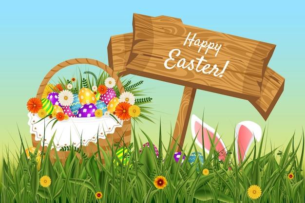 イースターの背景。テンプレート。草から突き出ているウサギの耳。花と草の中に突き出ているテキストハッピーイースターと木の板
