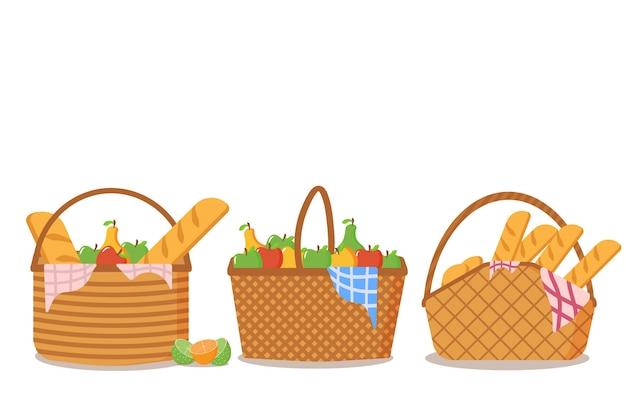 白い背景の上に食べ物がいっぱいのピクニックバスケットのセットです。ピクニックバスケットのコレクションには、屋外での食事用のおいしいフルーツとパンがたくさんあります。ピクニックデザインコンセプト。