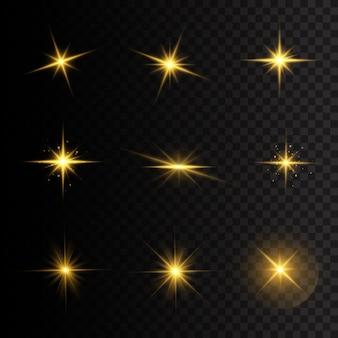 輝きのあるバーストスターのセット。黄色の光る星。光線とスポットライトで太陽のフラッシュ。透明な背景に分離された特殊効果。