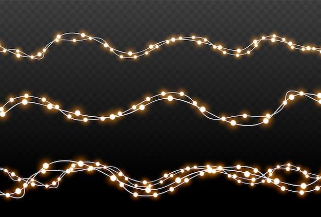 Рождественские огни изолированные реалистичные элементы дизайна. светящиеся огни