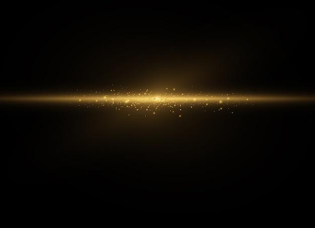 ほこりの火花と金色の星が特別な光で輝きます。透明な背景の上で輝きます。クリスマスライト効果。きらめく魔法のほこりの粒子。