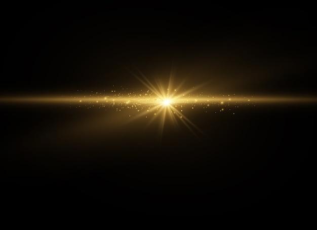 ほこりの火花と金色の星が特別な光で輝きます。透明な背景の上で輝きます。クリスマスライト効果。輝く魔法のダスト粒子内部