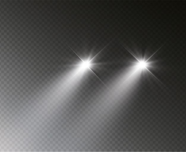 Силуэт автомобиля с фарами, светящимися в темноте.