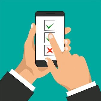 リストの概念を行うには。手は、スマートフォンと指タッチディスプレイを保持しています。電話スクリーンのチェックボックス。ビジネスマンはボタンを受け入れ、それをクリックします。図。