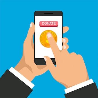 電話での寄付。男は寄付し、オンラインでお金を与えます。ゴールドコインと画面上のボタンを持つスマートフォン。