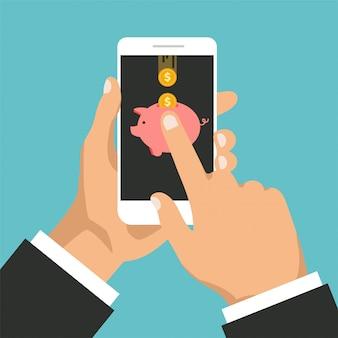 電話のディスプレイ上の金貨と貯金箱。モバイルバンキングのコンセプトです。キャッシュバックまたは返金。