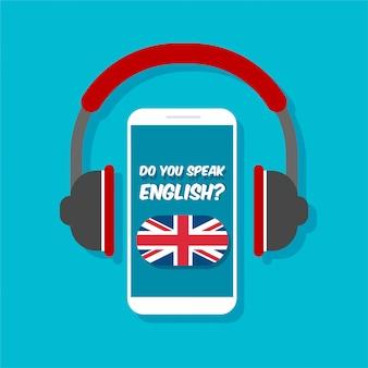 英語の概念を話しますか?オンライン学習。ヘッドフォン正面のスマートフォン。電話のディスプレイ上のイギリスの旗。