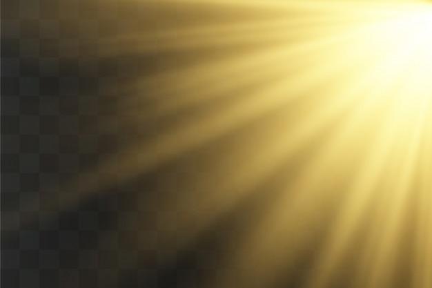 Световые лучи желтого спецэффекта с лучами света и волшебными блестками