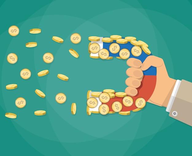 磁石とゴールドコインの実業家の手