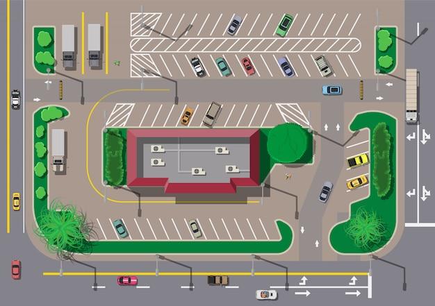 Кафе быстрого питания, ресторан и парковка для автомобилей.