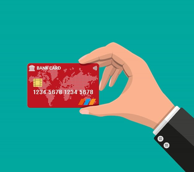 銀行カード、クレジットカードを手に
