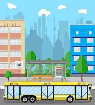 Автобусная остановка, город. дорога, деревья, мусорное ведро, облака