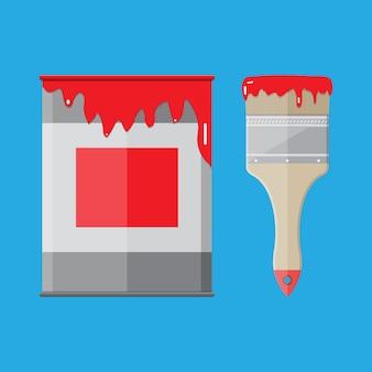 Металлическая консервная банка с красной краской и кистью