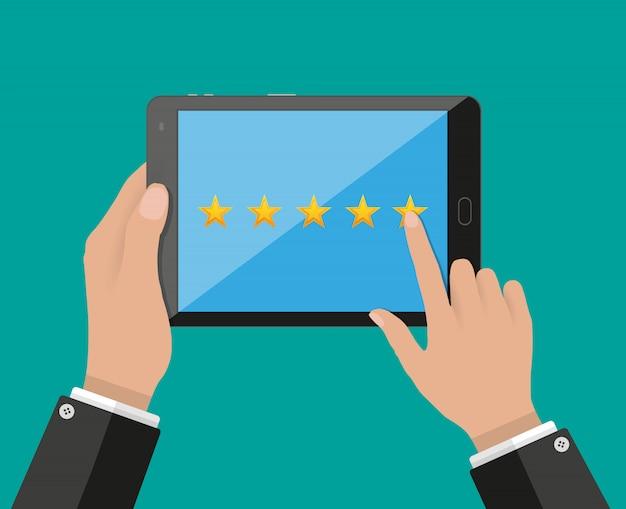 Планшетный пк с рейтингом пять звезд на экране