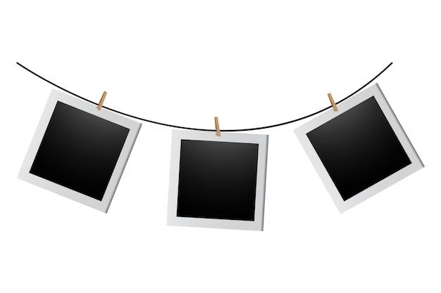 Печатные фотографии, висящие на веревке