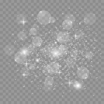 ほこりの火花と金色の星が特別な光で輝く