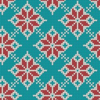 クリスマスは、幾何学的な雪のシームレスなパターンを編みます。ニットの青いセーター。
