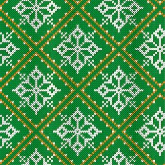 クリスマスは雪のシームレスなパターンを編みます。ニットの緑のセーターのデザイン。伝統的なニットの装飾的なパターン
