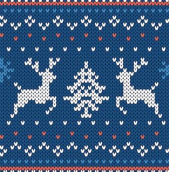 クリスマスは、青い色のムースと幾何学的な背景をニットします。ヘラジカとフェアアイルスタイルのセーターのニットパターン。