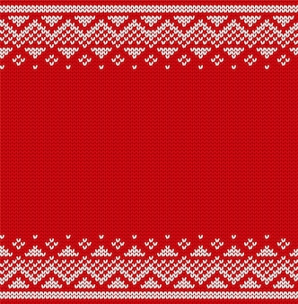 Рождественский образец. вяжем бесшовные. рождественские украшения. вязаный зимний свитер. новый год красный фон с местом для текста.