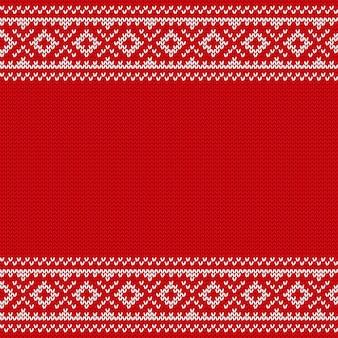 クリスマスのシームレスなパターンを編みます。ニットの質感。図。