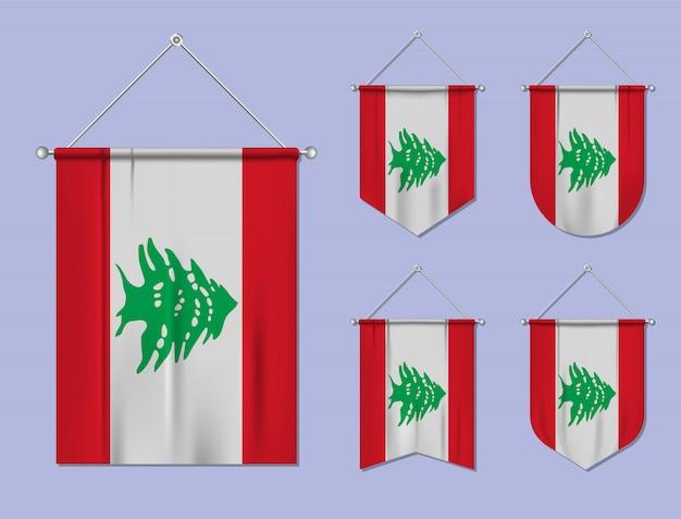 Набор висящих флагов ливана с текстильной текстурой. разнообразие форм национального флага страны. вертикальный шаблон вымпела