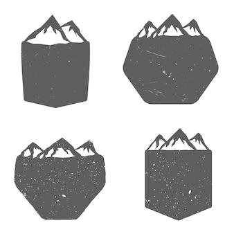 ビンテージモノクロスタイルの山と盾のセット。ベクトル図