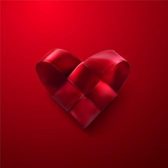 幸せなバレンタインデー。赤の現実的な編まれた心。編組サテンリボンハート形のバレンタインの日のシンボル。