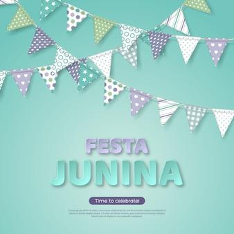 フェスタジュニーナの休日のデザイン。紙は明るい青緑色の背景に旗布の旗とスタイルの文字をカットしました。ブラジルやラテンの祭り、パーティー用のテンプレート