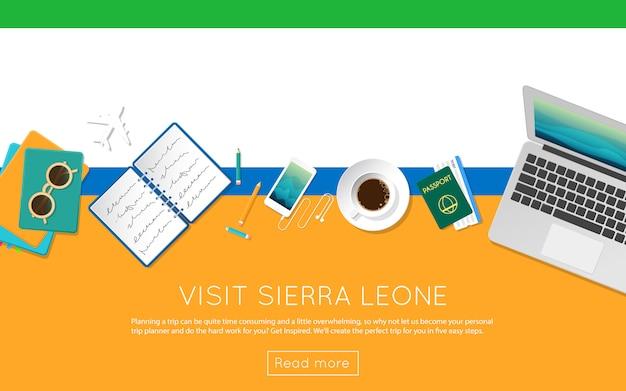 シエラレオネのコンセプトをご覧ください。シエラレオネの国旗のラップトップ、サングラス、コーヒーカップの平面図。フラットスタイルの旅行計画のウェブサイトのヘッダー。