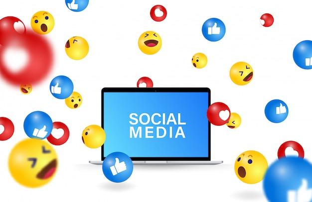 落ちてくるソーシャルメディアの絵文字、ノートパソコンのイラスト。コンピューターの画面とソーシャルメディアのアイコンと絵文字シンボルのコミュニケーションビジュアル