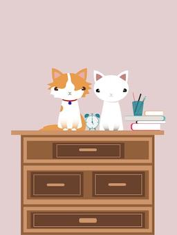 机の図にかわいい猫