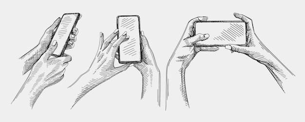 スマートフォンのジェスチャーの手描きのスケッチセット。このセットには、セルフィーを撮ったり手で写真を撮ったりする手、電話のロックを解除する手、電話で画像をズームする手が含まれます。