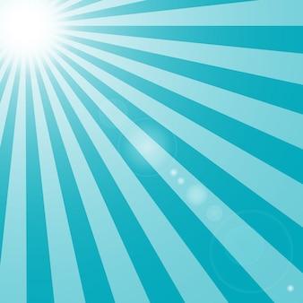 太陽とまぶしさの光線の背景の青い色