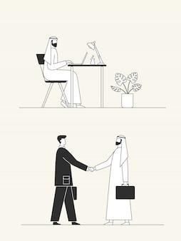 Арабский бизнесмен работает с ноутбуком в офисе. деловое рукопожатие, заключение сделки.