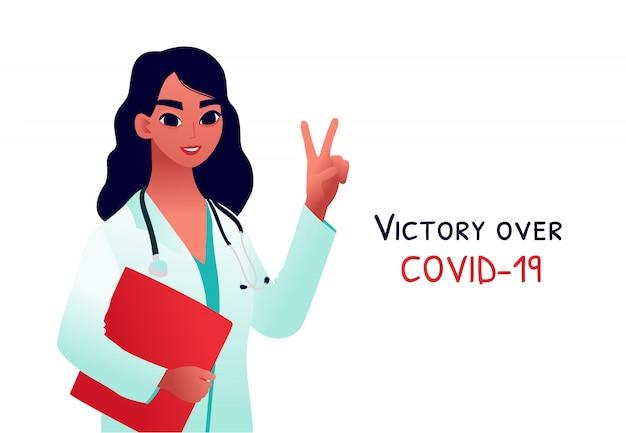 Молодой доктор в медицинском пальто показывает жест победы. концепция окончания карантина