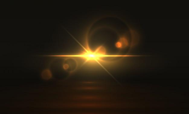 黄金の光の効果。輝くフレアの背景、黄色の魔法の抽象的な輝き現実的な透明なキラキラ。金色の明るい光