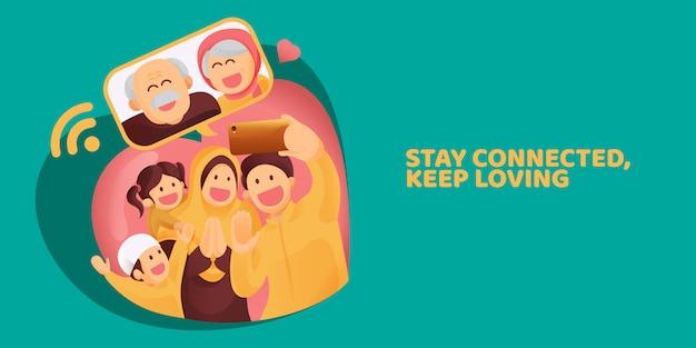 イスラム教徒の家族がスマートフォンビデオ通話で長老や両親に連絡し、イードムバラクのお祝いに愛情を示す