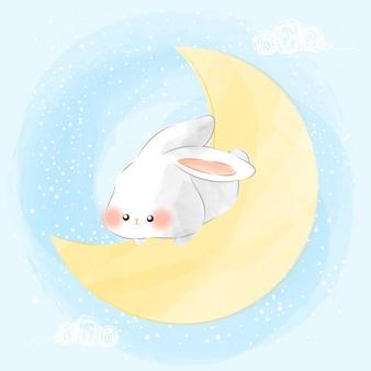 月に座っているかわいいウサギ