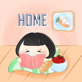 Милая маленькая девочка читает книгу
