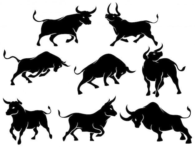 牛のシルエットのセット。さまざまなポーズのスペインの闘牛のコレクション。