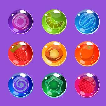 ゲームセットの輝きと明るくカラフルな光沢のあるキャンディー