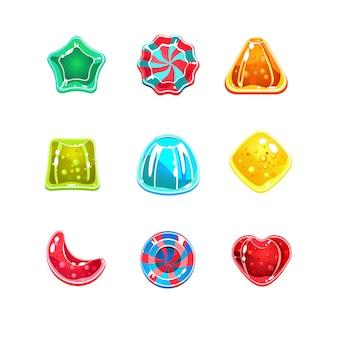 さまざまな形の光沢のあるカラフルなキャンディー