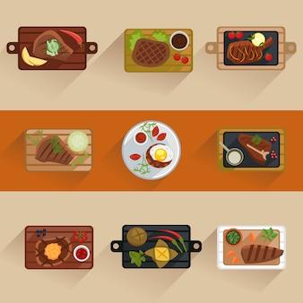 分離されたフラットアイコンを調理魚と肉のステーキ