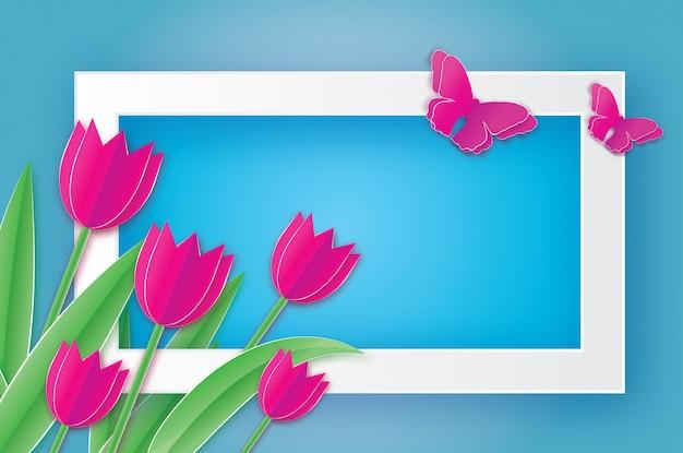 ピンクのチューリップと蝶。女性の日。