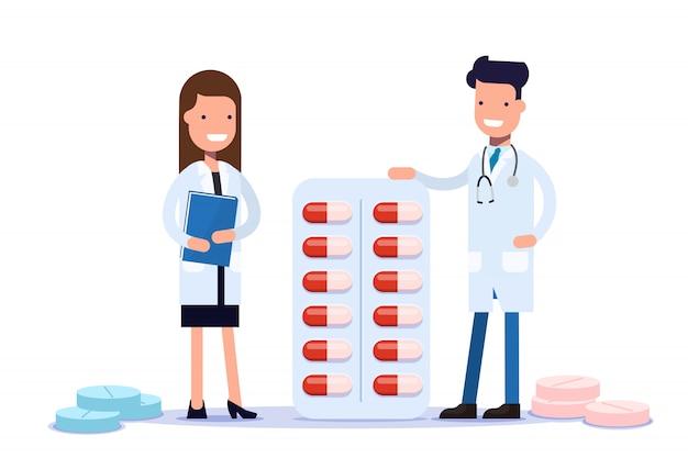 医師の男性と女性が薬の近くに立っています。