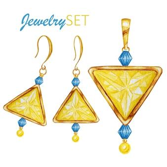 緑のエメラルドドロップ、金色の要素が入った黄色の三角形のクリスタルジェムストーンビーズ。白い背景の上の黄金のペンダントとイヤリングを描く水彩画。美しいジュエリーセット。